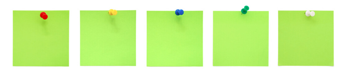 Green sticky notes with push pins