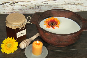 milk and honey on wood