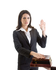 Woman Hand Raised Swearing on a Stack of Bibles Isolated White