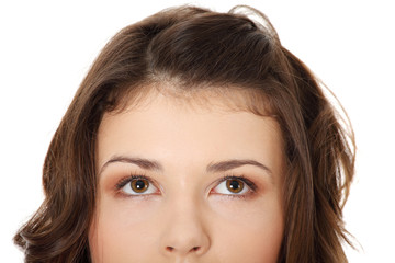 Young teen girl with her eyes looking up