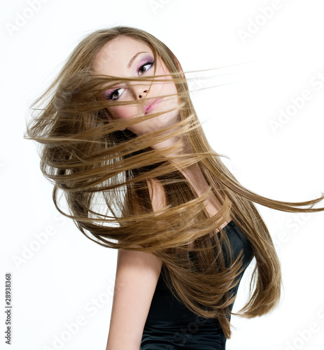 teen girl shaking head with long hair
