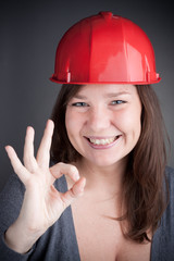 Young Engineer Woman doing the ok sign