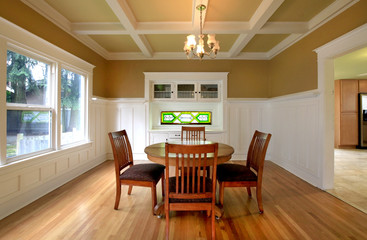 Dining room in a historical home with white molding
