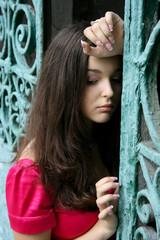 Young caucasian woman near the gates