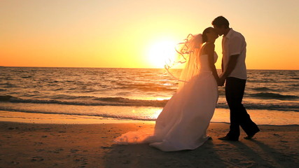 Sunset Beach Wedding Kiss