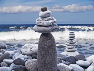 Pebbles stacked over the sea shore