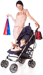 a young woman is standing near a pram and holding bright paper b