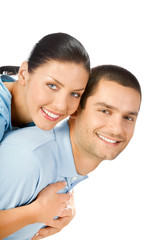 Portrait of young happy smiling embracing couple, on white