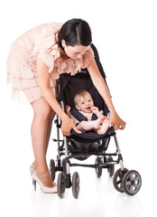 a young woman is standing near her child in a pram