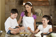 Mother, Son & Daughter Family In Kitchen Cooking Baking