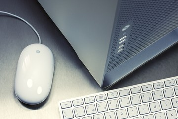 Close-up of PC desktop, keyboard, mouse on metal background