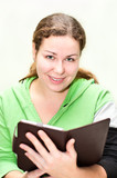 Beautiful girl holding ebook in hands poster