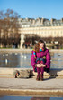 Pretty young girl in bright clothes in the Tuilleries garden in
