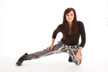 Street dancer girl in black boots on white background