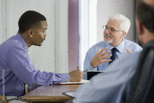 Three men meeting in an office