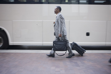 African American businessman heading for a bus