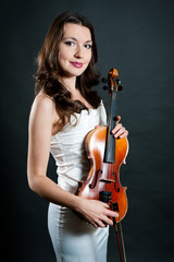 violinist on black background