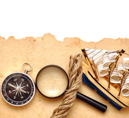 rope, loupe, compass and model classic boat