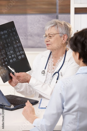 Doctor explaining patient scan results.
