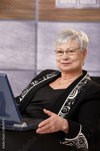 Senior businesswoman with laptop