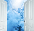 white doors opening to heavenly scene