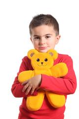 bambino abbraccia orsacchiotto