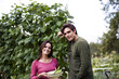 A young couple standing on an allotment