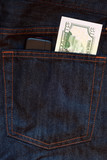 Mobile phone and one dollar banknote in jeans