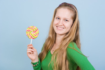 Beautiful young woman with long hair with candy