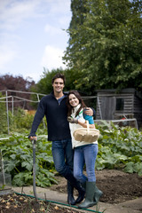 A young couple working together on an allotment