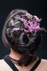 Evening hairstyle with flowers.