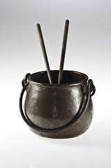 Copper pot with chopsticks