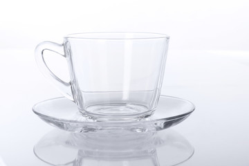 Transparent glass cup and saucer