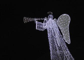 Angel playing on trumpet, xmas illumination in Krakow, Poland