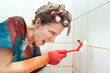 angry woman cleaning bathroom with brush
