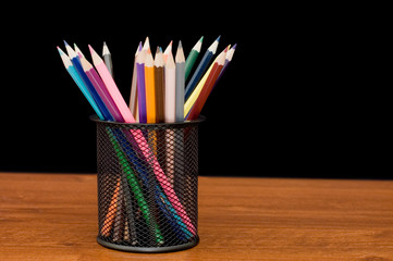 Various colour pencils on a wooden table