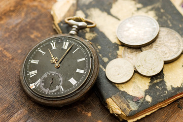 The old book, old watch and money
