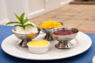 strawberry jam and cheese served with sconce