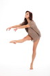 Girl in dancing pose right leg and arms extented