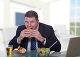 man at office working and eat unhealthy fast food poster