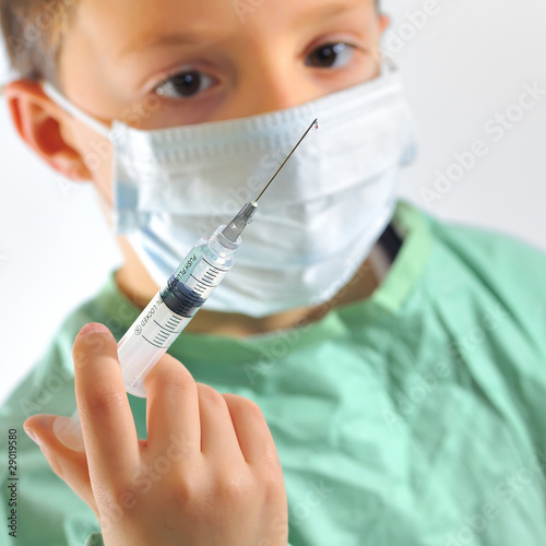 a little boy in a doctors uniform