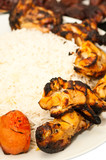 closeup of grilled chicken and tomatoes with rice