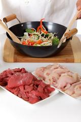 Oriental food preparing in wok