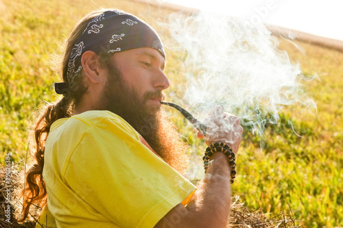 man smokes a pipe