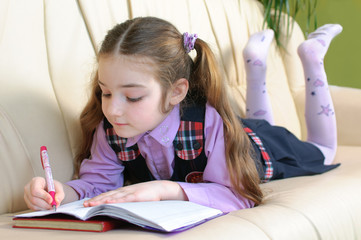 School girl doing homeworks