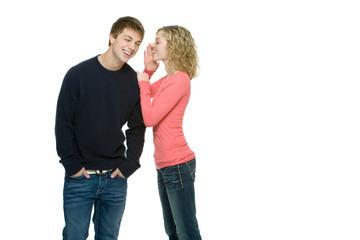 Attractive teenagers gossiping