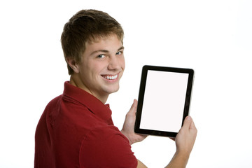 Attractive teenage boy holding an electronic tablet
