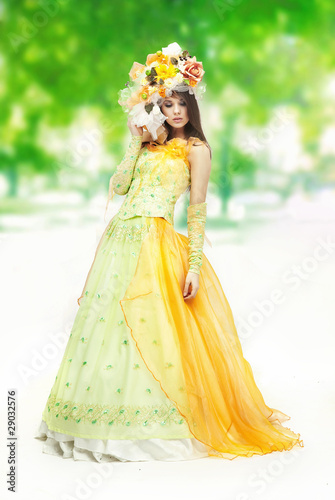 Young woman on the nature background
