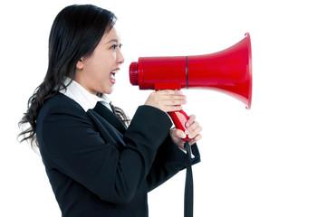 Attractive businesswoman using megaphone