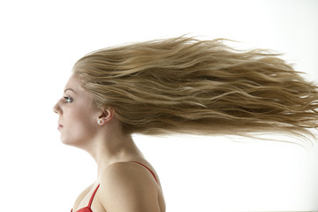 Stunning teenage girl with extreme blowing hair